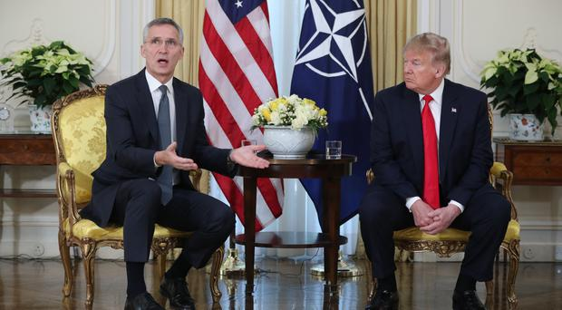 US President Donald Trump, right, with Nato Secretary General Jens Stoltenberg at the start of the 2019 Nato Summit (Jonathan Brady/PA)