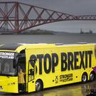 SNP leader Nicola Sturgeon with the SNP campaign bus in front of the Queensferry Crossing (Jane Barlow/PA)