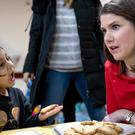 A young girl talks to Liberal Democrat Leader Jo Swinson during a visit to the Parkview Community Playgroup in Hampshire (Aaron Chown/PA)