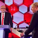 Boris Johnson and Jeremy Corbyn during their debate on Friday night (BBC Handout/PA)