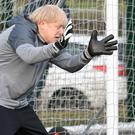 Prime Minister Boris Johnson tries his hand in goal before a football match between Hazel Grove Utd and Poynton Jnr under 10s in the Cheshire Girls football league in Cheadle Hume (Stefan Rousseau/PA)