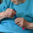 Government figures show nearly 15 pensioners a day run out of money struggling to pay for the cost of care (Joe Giddens/PA)