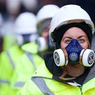Climate change activists wearing gas masks and blocking a central London road (Gareth Morris/Extinction Rebellion/PA)
