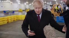 Screen grab from ITV of Prime Minister Boris Johnson looking at the photograph of four-year-old Jack (ITV/PA Wire)