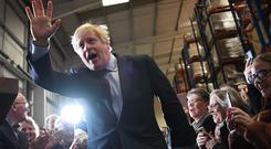 Boris Johnson remains on course for a Commons majority, according to YouGov's MRP prediction (Stefan Rousseau/PA)
