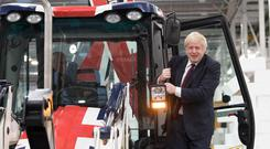 Prime Minister Boris Johnson during a visit to JCB Cab Manufacturing Centre in Uttoxeter, while on the General Election campaign trail (Stefan Rousseau/PA)
