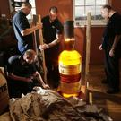 The bottle being unboxed at The Scotch Whisky Experience in 2012 (Danny Lawson/PA)