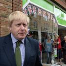 Boris Johnson at Uxbridge Library in west London (Stefan Rousseau/PA)