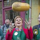 SNP leader Nicola Sturgeon during a visit to Digin Community Greengrocer in Edinburgh (Jane Barlow/PA)