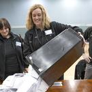 Ballot boxes are emptied at The Leisuredrome in Bishopbriggs for the East Dunbartonshire seat (Jane Barlow/PA)