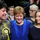 First Minister Nicola Sturgeon celebrates with supporters at the SEC Centre in Glasgow (PA)
