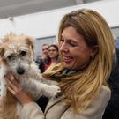 Prime Minister Boris Johnson's partner Carrie Symonds and dog Dilyn (Stefan Rousseau/PA)