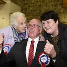 Jim Shannon of the DUP celebrates with his mother Mona Shannon and wife Sandra (Michael Cooper/PA)
