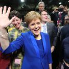 First Minister Nicola Sturgeon celebrates with supporters at the SEC in Glasgow (Andrew Milligan/PA)