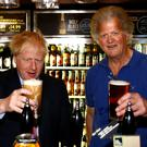 Boris Johnson and Tim Martin (Henry Nicholls/PA)