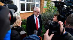 Jeremy Corbyn faces the media outside his house