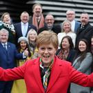 First Minister Nicola Sturgeon celebrates as she joins SNP's newly-elected MPs for a group photo call outside the VandA Museum in Dundee (Andrew Milligan/PA)
