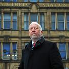 Shadow transport secretary Andy McDonald outside Manchester Victoria railway station (Peter Byrne/PA)