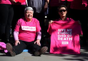 Activists from the Campaign for Dignity in Dying outside the Royal Courts of Justice in London (Kirsty O'Connor/PA)