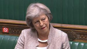 Former PM Theresa May listens to the response from Cabinet Office minister Michael Gove after she asked a question in the Commons on the appointment of the new national security adviser (House of Commons/PA)