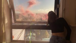 Student have occupied an uninhabited residential building, lighting flares from its windows (@rentstrikeUoM/Twitter)