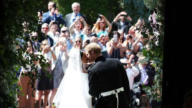 Members of the public gathered in Horseshoe Cloister greet Harry and Meghan (Danny Lawson/PA)