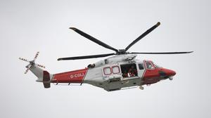 A Coastguard helicopter (Andrew Matthews/PA)