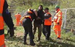 Cucierean being detained on another occasion, after an alleged breach of the anti-trespass injunction. (HS2 Ltd/PA)