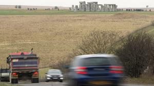 Traffic passing Stonehenge on the A303 road in Wiltshire (Steve Parsons/PA)