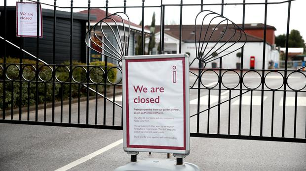 A sign in front of closed gates at Squire's Garden Centre in Farnham, Surrey (Adam Davy/PA)
