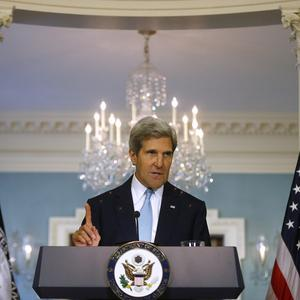 US secretary of state John Kerry makes a statement about Syria (AP)