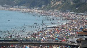 Crowds on the beach in Bournemouth on Thursday (Andrew Matthews/PA)