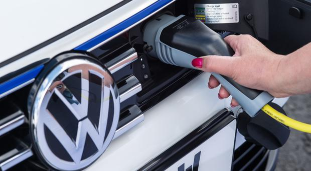 Electric cars hold a 1% share of the UK's new car market (Volkswagen/PA)