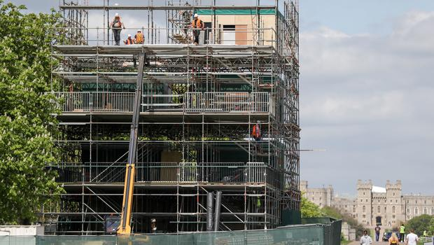 Workmen help construct broadcast studios on the Long Walk in Windsor, ahead of the royal wedding (Andrew Matthews/PA)