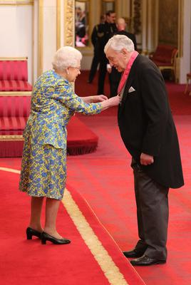 The Queen honoured Willie John McBride with his CBE (Dominic Lipinski/PA)