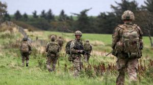 Soldiers from the Royal Scots Dragoon Guards patrolling during Exercise Solway Eagle at the Kirkcudbright training area (Andrew Milligan/PA)
