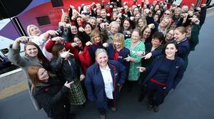 The all-female crew of the rebranded LNER Flying Scotswoman service celebrate their arrival at King's Cross station (Jonathan Brady/PA)