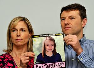Kate and Gerry McCann in 2012 holding an image of what Madeline might look like as an older girl (John Stillwell/PA)