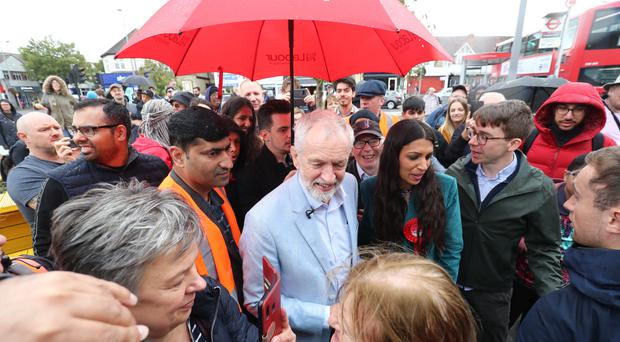 Jeremy Corbyn with Labour Party parliamentary candidate for Chingford and Woodford Green Faiza Shaheen during a visit to Chingford, where he announced that Labour plans to scrap Universal Credit (Gareth Fuller/PA)