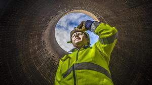 A worker in a cooling tower at Ferrybridge C Power Station in West Yorkshire (Danny Lawson'PA)
