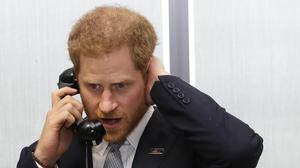 The Duke of Sussex on the phone during the 15th BGC annual charity day (Kirsty Wigglesworth/PA)