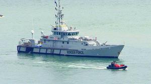 Border Force cutter Seeker in the harbour (PA)