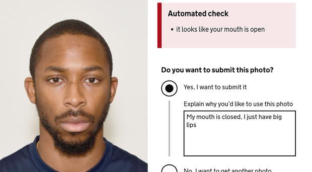 Joshua Bada, who was stunned when the automated photo checker on the passport renewal website mistook his lips for an open mouth (PA)