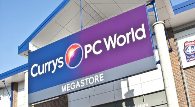 Thousands of tills were affected at Currys PC World and Dixons Travel stores (PA)