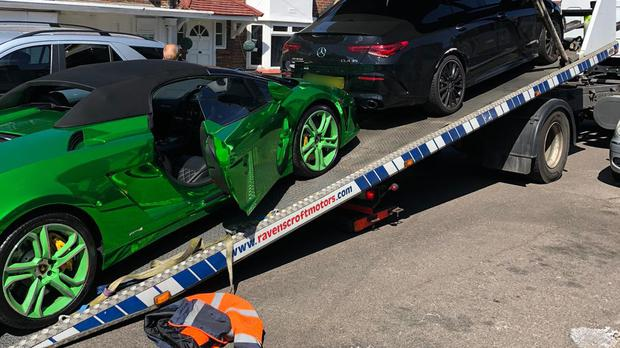 The Lamborghini being loaded onto a recovery vehicle (Handout/Metropolitan Police/PA)