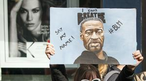 People take part in a Black Lives Matter protest rally in Manchester (PA)