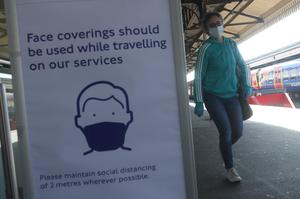 A sign advising passengers to wear a face mask at Clapham Junction station (Yui Mok/PA)