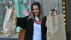 A customer carrying bags of shopping leaves Primark in Birmingham (Jacob King/PA)