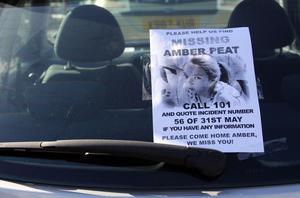 A poster on a car windscreen during the search (PA)