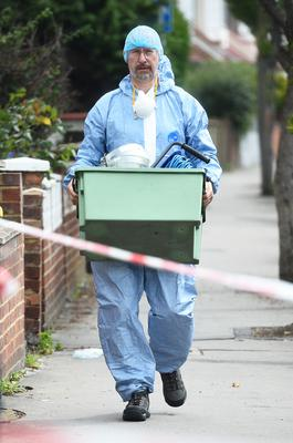 A forensics officer at the scene (Kirsty O'Connor/PA)